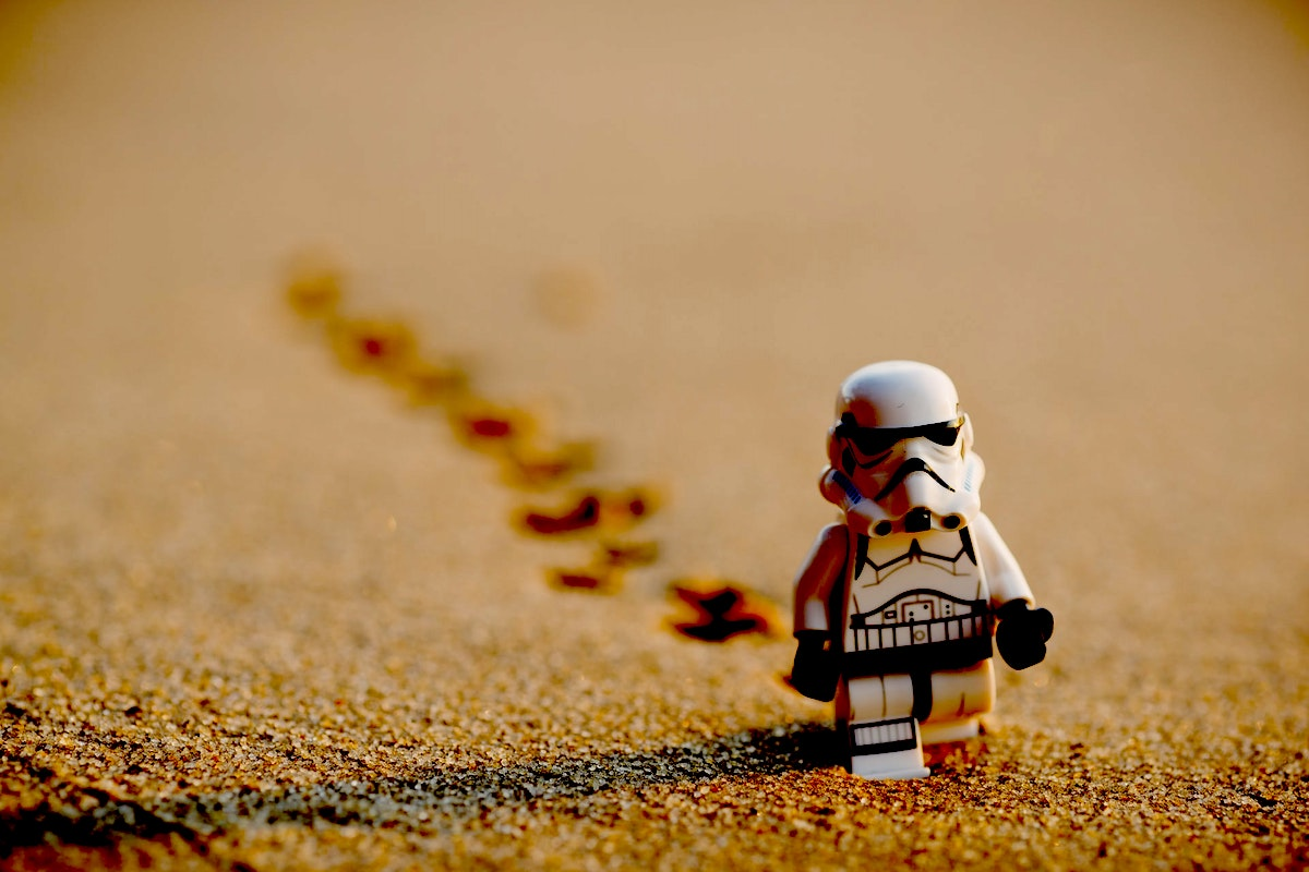 Lego Storm Trooper walking in the desert